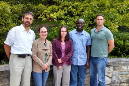 former MRFN fellows pose for a picture in the garden above Penn State's Materials Characterization Lab
